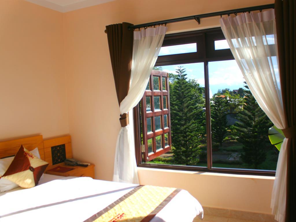 Phòng ngủ Coffee tour resort - khách sạn Buôn Mê Thuột