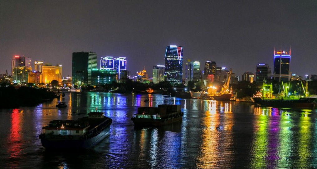 Watching Bach Dang wharf at night - a romantic city place