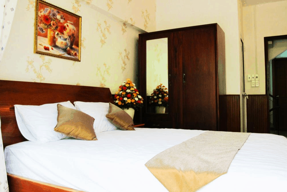 Phòng nghỉ 1 giường lớn tại nhà nghỉ Anh Đào Guesthouse