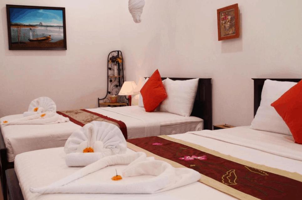 Phòng nghỉ 2 giường tại khách sạn Mango Home Riverside