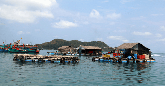 Fish-raising cages are spread out on Ngang island