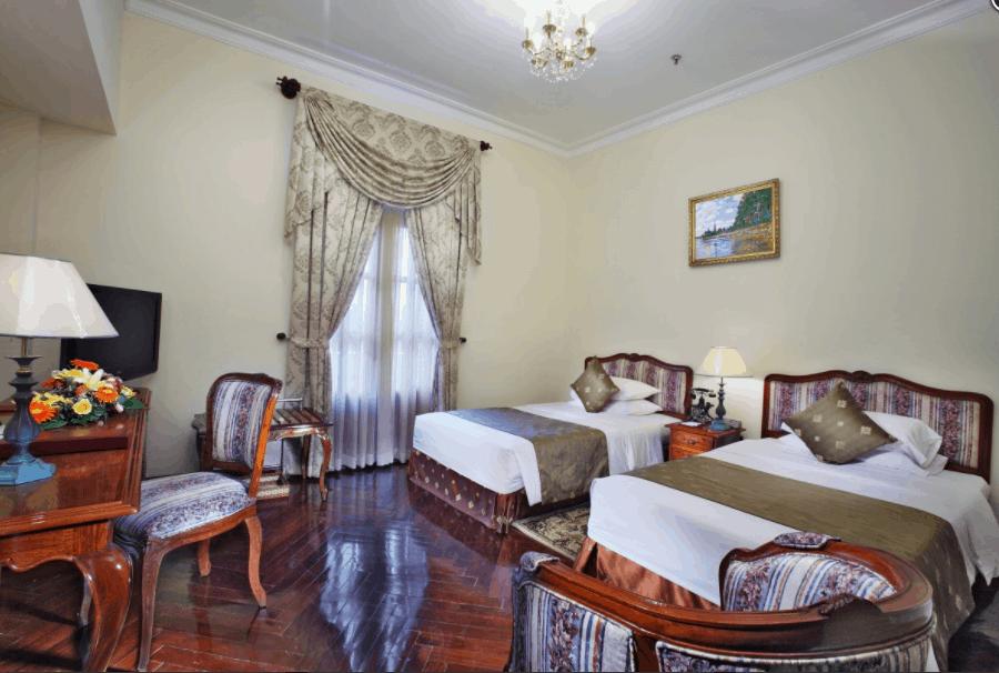 Hình ảnh phòng nghỉ 2 giường đơn tại khách sạn Grand