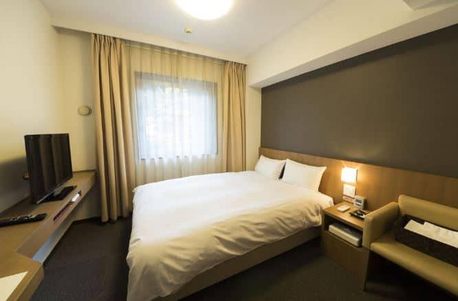 phòng ngủ tại khách sạn Dormy Inn Umeda Higashi Natural Hot Spring