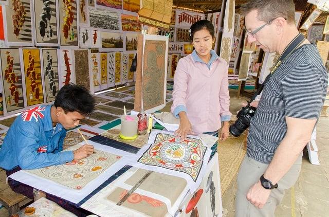 Hình ảnh về Phật giáo được in trên tranh cát (Ảnh ST)