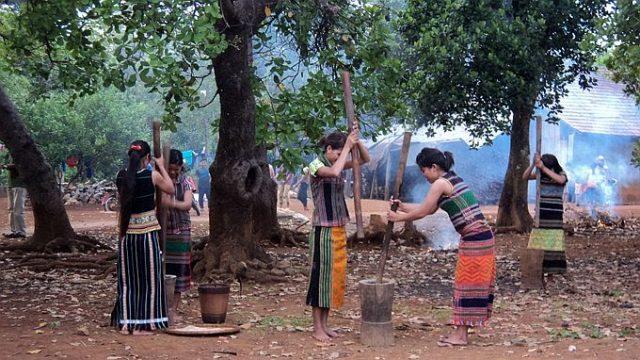 S'Tieng ethnic people pounding rice in Soc Bom Bo