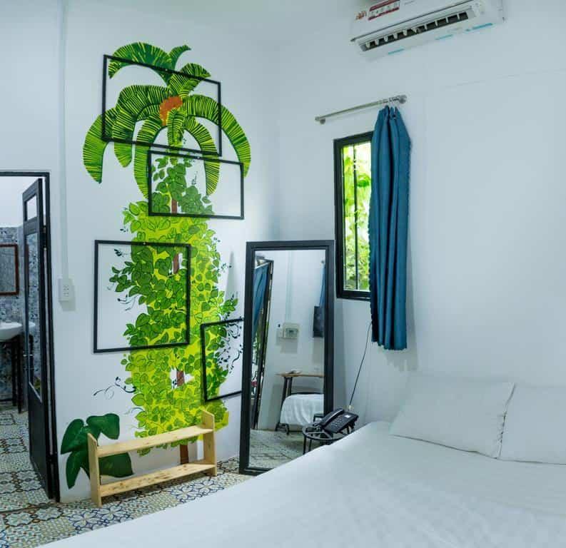 Phòng nghỉ sử dụng gam màu tương phản đen trắng và không quên bổ sung sắc xanh tươi mát
