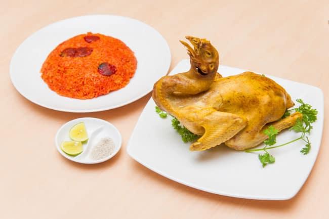 Xôi gấc và thịt gà là món ăn mang đến may mắn trong ngày mùng 1 đầu tháng. Ảnh: Internet